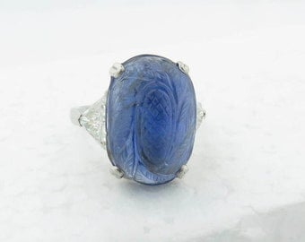 Vintage Platinum Carved w/Floral Design Oval Cabochon Semi Transparent Natural Medium Blue Sapphire & Trillion Cut Diamond Ring / Size: 5.5.