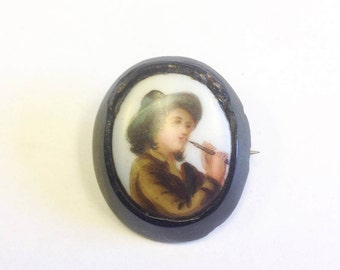 Antique, Victorian, Whitby jet brooch with a portrait miniature of a musician.