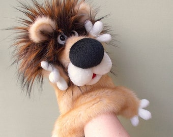 Lion. Big leo. Bibabo. Puppet. Toy on hand. Toy glove. Puppet theatre. Marionette.
