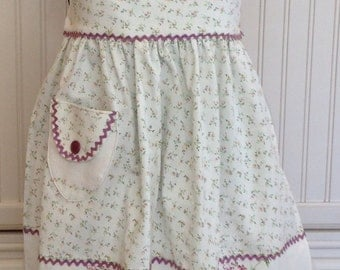 Vintage linens women's full apron lavender green purple ric rac trim lilacs on ruffled hem empire waist