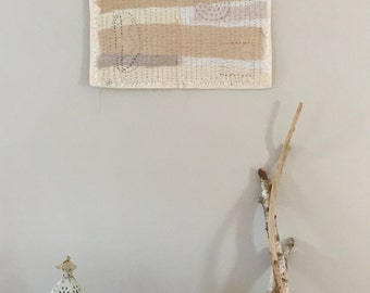beige and grey silk wall hanging