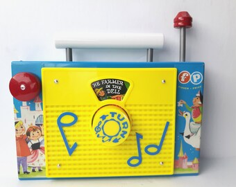 Fisher Price Radio Toy Reproduction: The Farmer in the Dell Wind-up Music Box Toy TV Radio - Turn the Knob - 1990s