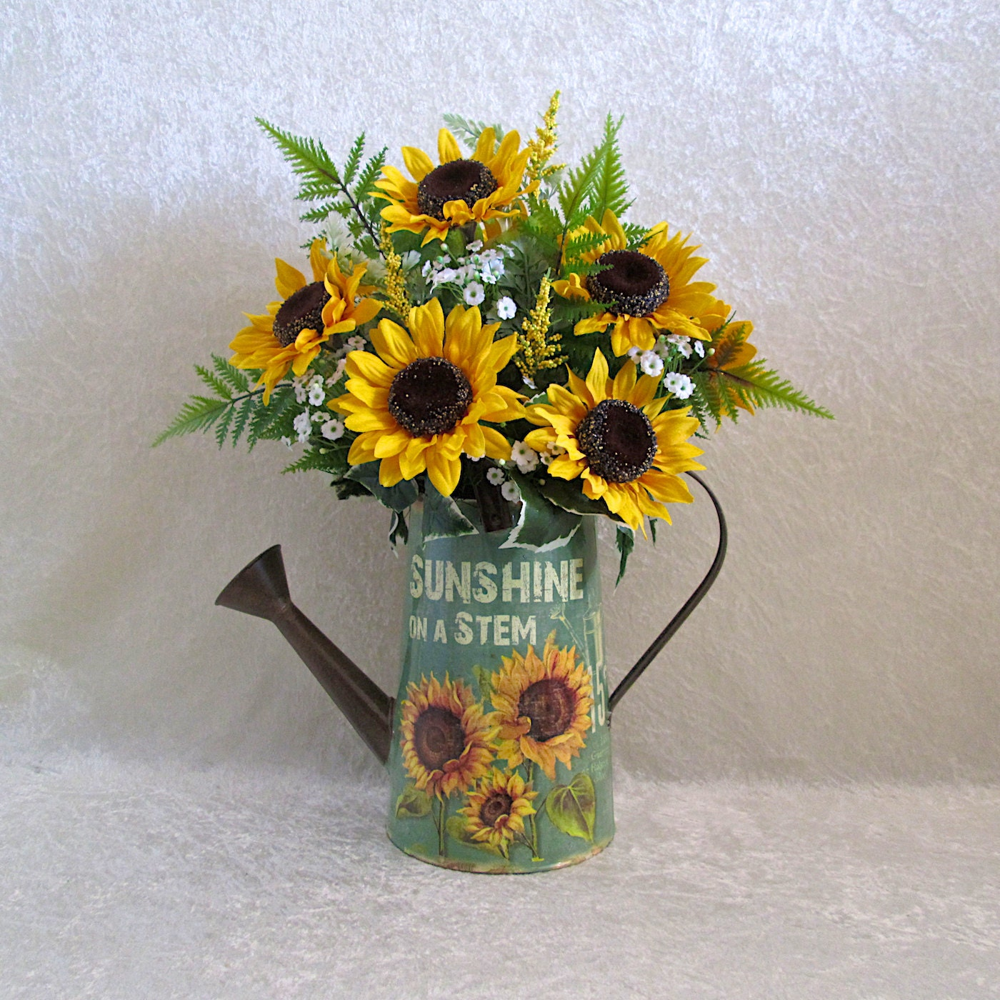 Silk sunflower arrangement in a watering can floral