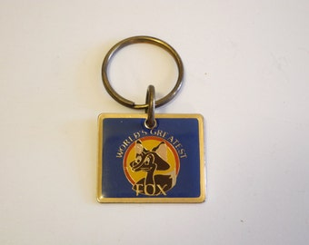 1970s World's Greatest FOX brass & enamel novelty keychain