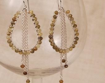 Gossamer garnet teardrops with falling gems