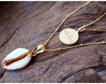 Lovely tiny cowrie shell necklace gold dipped.