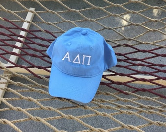 """Alpha Delta Pi - Light Blue Hat With White Letters With """"EST (with a greek """"s"""") 1851 on the back"""