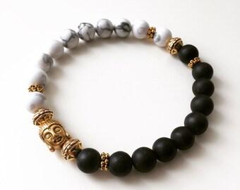 Men's Onyx and Howlite gemstone bead bracelet with gold spiritual Buddha charm, Enlightenment, Namaste, yoga gift meditation