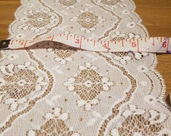 Stunning vintage lace trim wide lace double edged trim slight elasticity 5.5 inches wide x 1.4 metres length . White lace. Made in France