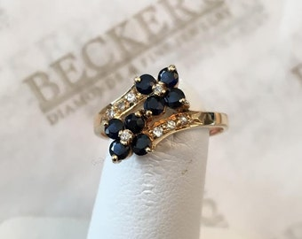 14k yellow gold ring with 8 Round Blue Sapphires and 8 Diamonds in a Double Flower Bypass, .87 tw size 6