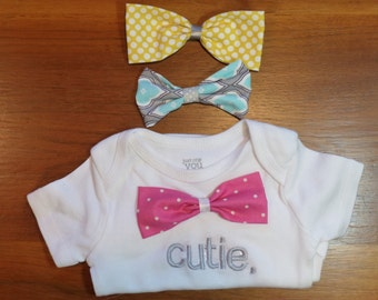 Interchangable bowties with Cutie onsie