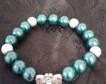 A mix of Teal and Silver