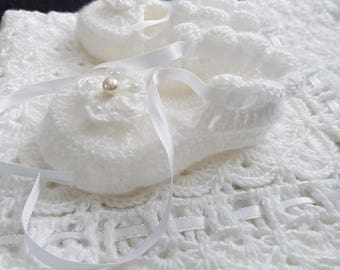 Crochet baptism booties for a baby girl