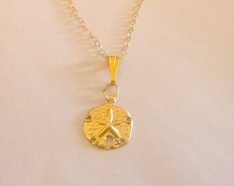 Authentic 20 inch 14 K Gold Chain with 14 mm Sand dollar Starfish pendant