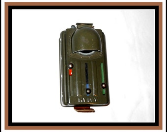 My Day military flashlight. Vintage flashlight with three different color filters. Army flashlight made of plastic that runs on batteries.