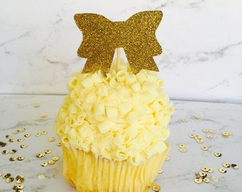 Set of 20 gold glitter bow cupcake toppers. Ships within 2-5 business days.