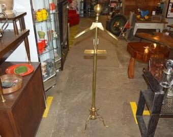 Brass coat hangar display