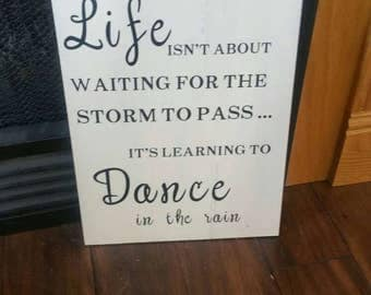 Life isn't about waiting for the storm to pass it's learning to Dance in the rain. Dancing in the rain, inspirational signs, life lessons
