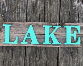 Lake sign on rustic wood
