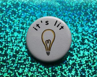 "it's lit | 1.25"" pinback button"