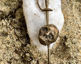 Pirate Sword in skull necklace charm. Hand casted in bronze