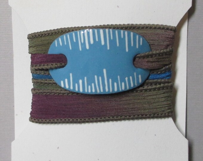 handmade yoga silk wrap bracelet with blue and white enameled slide