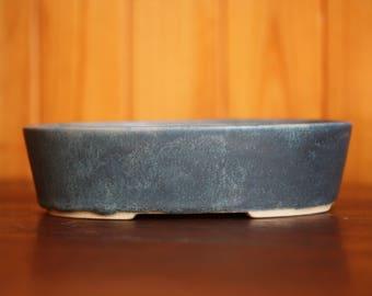 Hand slipcast bonsai pot with a matte blue green glaze