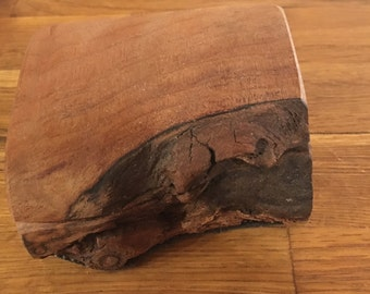 Small rustic wooden box with some bark intact