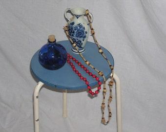Original age three leg stool, light blue plastic coating