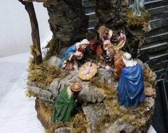 Nativity scene on wood stump