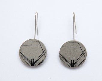 Concrete earrings with electricity tower print