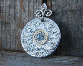 Hand Engraved Sterling Silver Pendant with 24 Karat Gold and Blue Topaz
