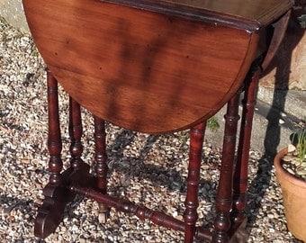 Antique drop leaf mahogany side table