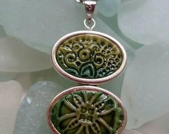 Spinning green tile pendant