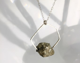 Long sterling silver and pyrite necklace.
