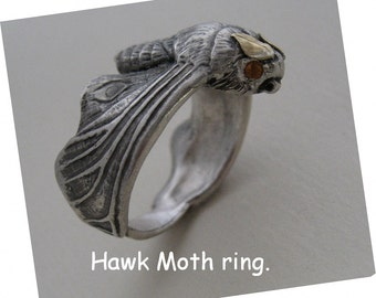Hawk moth ring now with pink spinel eyes.