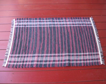 Handwoven red and black cotton striped rug