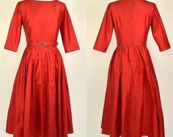 Vintage raw silk size 8 handmade 1950s boat neckline red dress with 3/4 sleeves