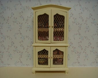 1/12th cream country kitchen cabinet filled with pots.