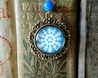 Festive Snowflake brass book hook bookmark with dangling glass cabochon accent