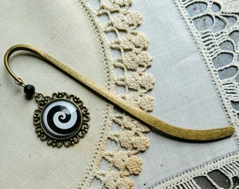 Black and white spiral brass book hook bookmark with dangling glass cabochon accent
