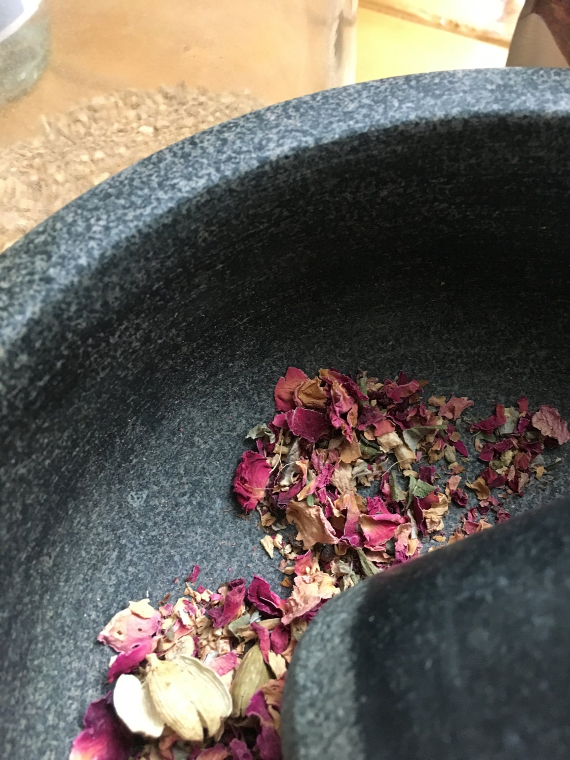 Add rose petals and ginger root and gentle use your mortar and pestle to open and blend
