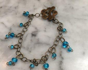 Bronze and blue flower bracelet