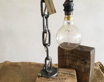 Handmade chain lamp on wine printed waxed wooden block