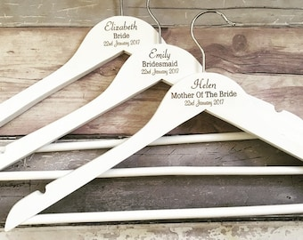 White bridal hangers, middle only name/role/date
