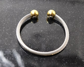 Vintage stainless steel twisted cable cuff bracelet with gold ball caps including magnets