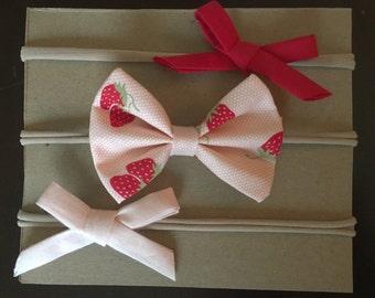 Pink and red strawberry headband set