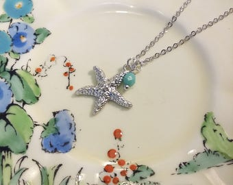 Pretty starfish charm necklace, silver plated.