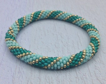Nepal roll on Bangle Bracelet. Beaded Bracelet Handmade by Ramila Beads, Green and Gold Hippie Bracelets.