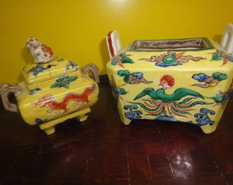 Oriental set of two sugar jars  Chinese early 20th century in yellow glaze